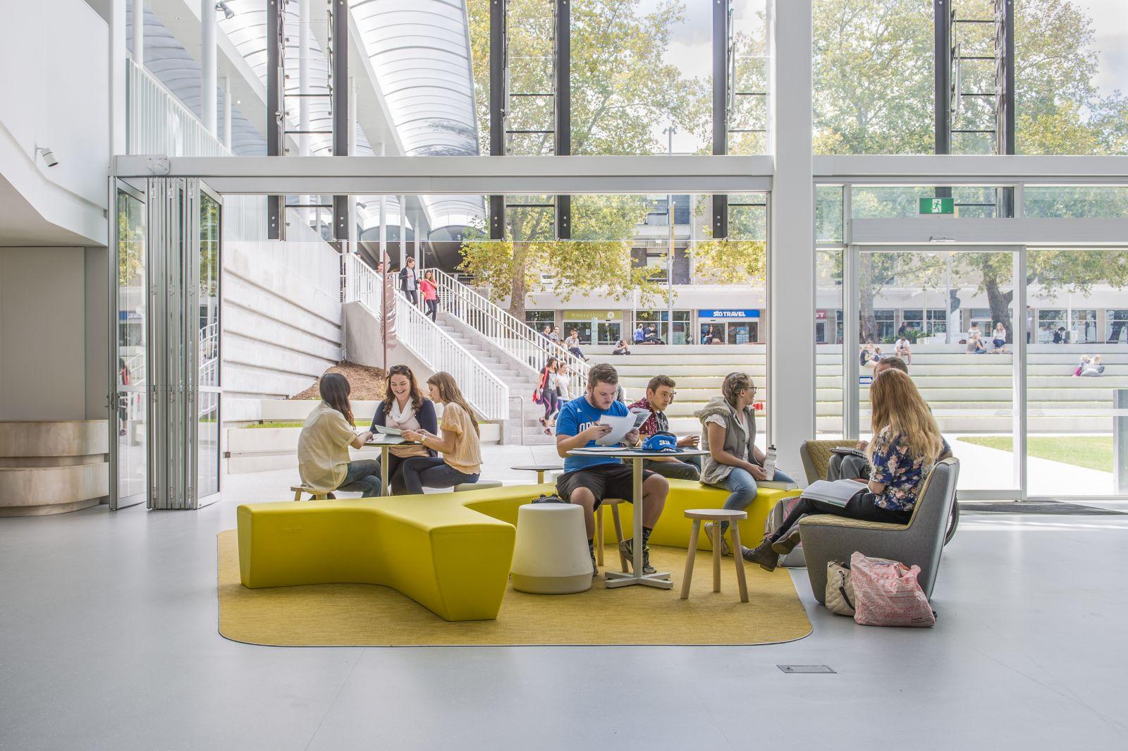 Students sitting in daylit atrium at Flinders University