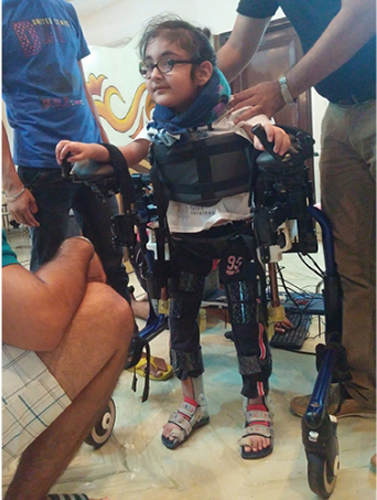 Manmeet Maggu's nephew Praneit takes the exoskeleton for a test drive in India