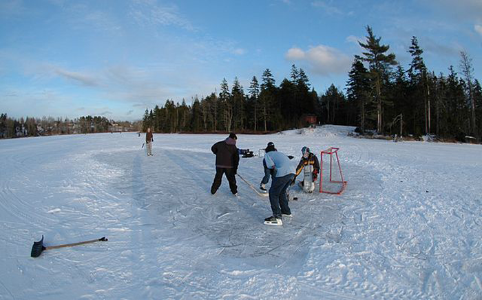 Game of pond hockey in Nova Scotia (photo by Spencer Gillis – Northland Films, public domain)