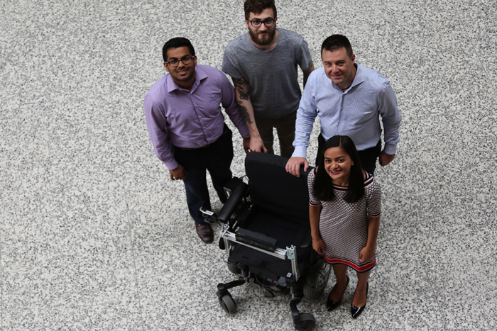 Clockwise from left, Marian Daniel, Patrick Howell, Assistant Professor Jonathan Kelly and Maya Burhanpurkar are part of a research team working on a low-cost system that enables electric wheelchairs to become partly or fully autonomous